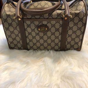 Gucci brown monogram leather speedy bag,